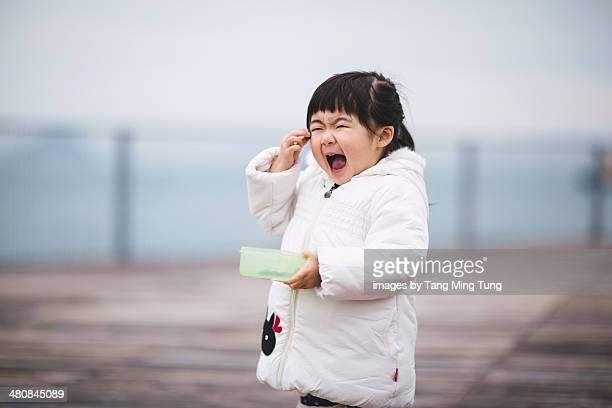Toddler girl having snack  at promenade