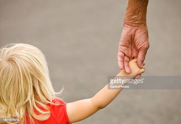 Toddler Girl Holding Grandfather's Hand