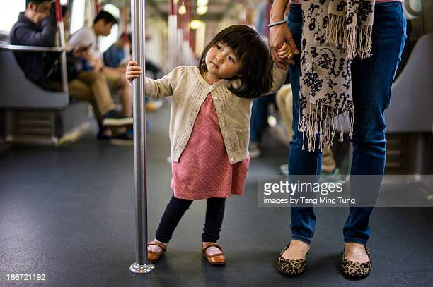 Toddler girl holding handrail