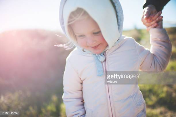 Toddler Girl Holding Hands with Mother