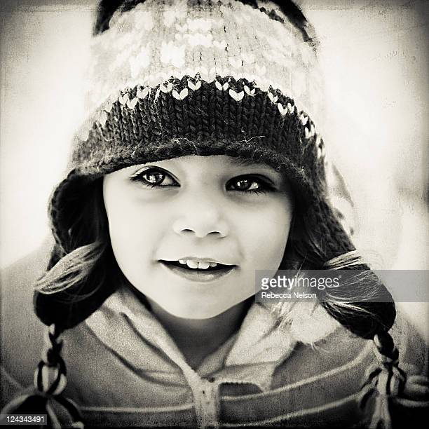 Toddler girl in coat and hat