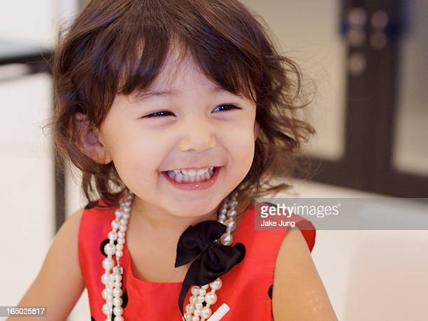 Toddler girl in formal clothes smiling