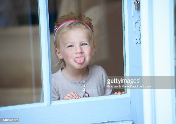 toddler girl in tiara making a face - saint ferme stock photos and pictures
