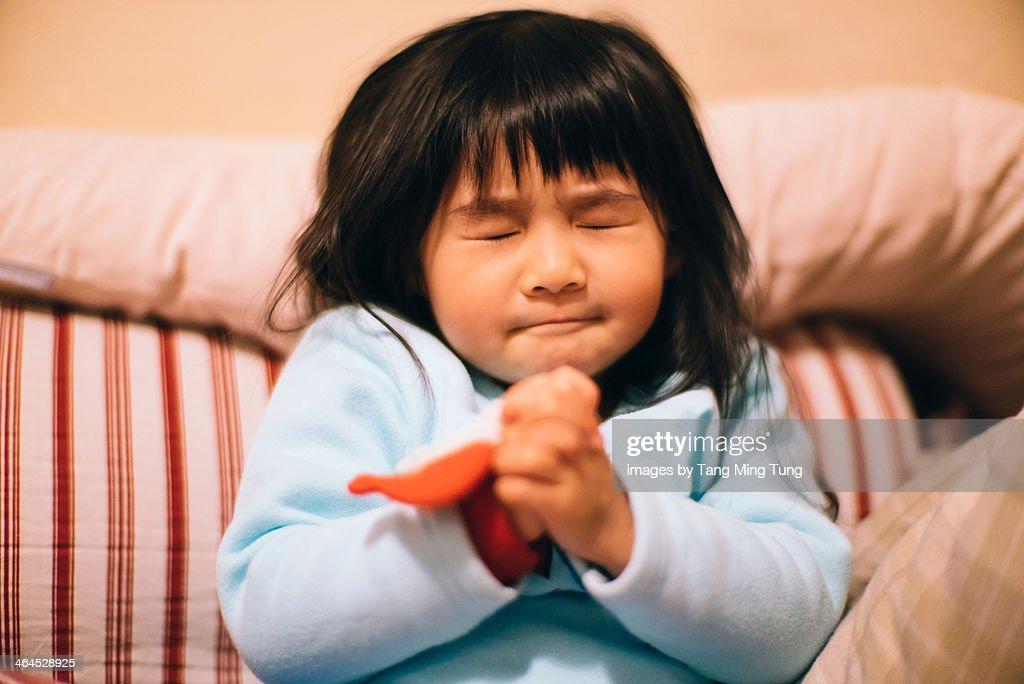 Toddler girl making wish / praying sincerely : Stock Photo