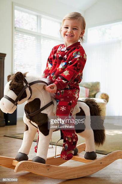 Toddler girl on rocking horse