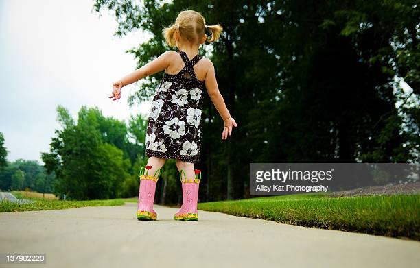 Toddler girl on street