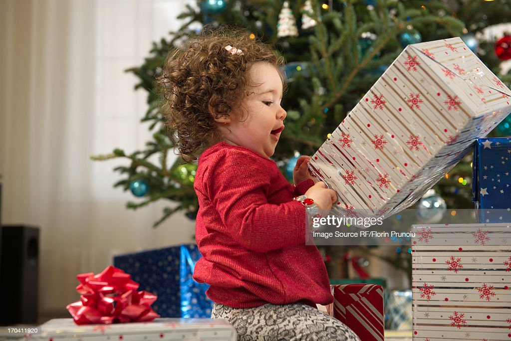 Toddler Girl Opening Christmas Gifts Stock Photo | Getty Images