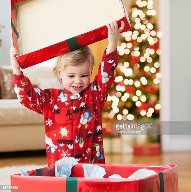 Toddler girl opening presents