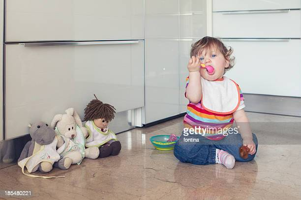 toddler girl playing with her dolls