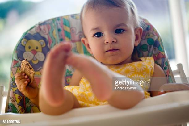 Toddler girl playing with her feet