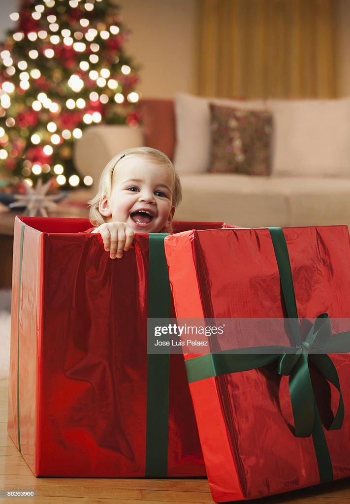 toddler girl popping out of gift box stock photo getty images