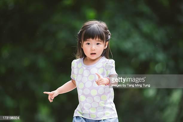 Toddler girl running in the park