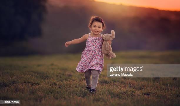 Toddler Girl Running Toward Me At Sunset