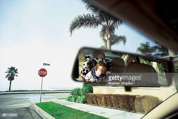 Toddler girl sleeping in car seat, Corona del Mar, California,
