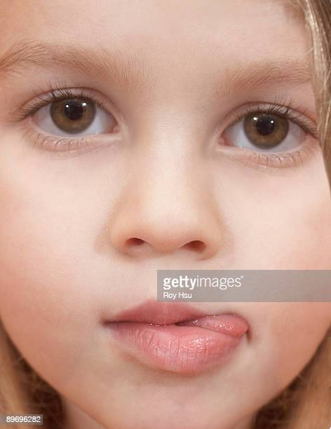 Toddler girl sticking tongue out