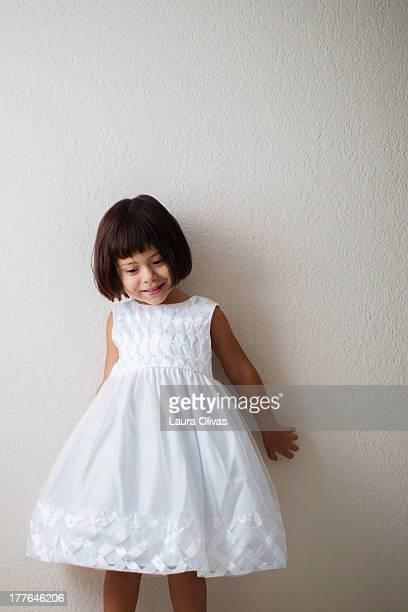 Toddler Girl Wearing a White Dress