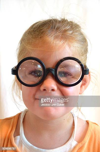 toddler girl wearing coke bottle glasses - lynn pleasant stock pictures, royalty-free photos & images