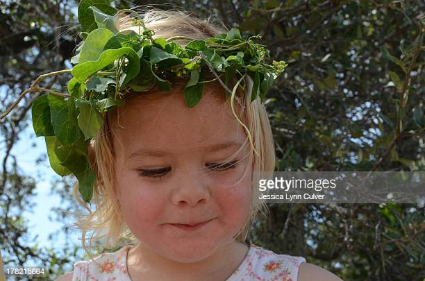 Toddler Girl Wearing Crown of Leaves