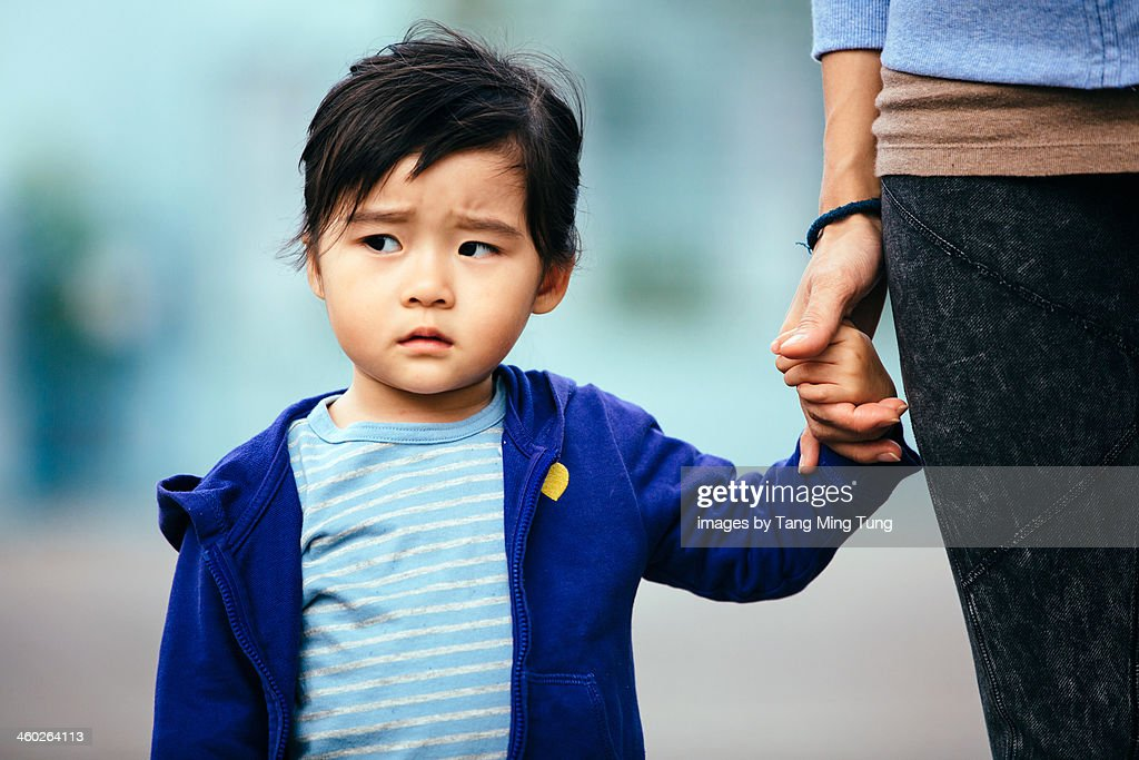 Toddler girl with a serious looking face : Stock Photo