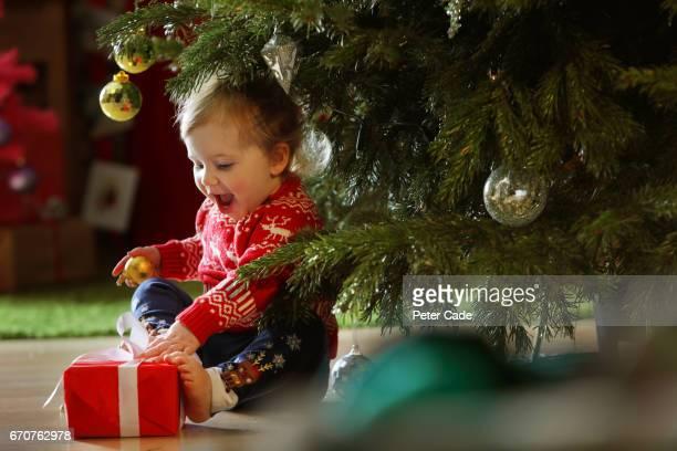 Toddler girl with Christmas tree