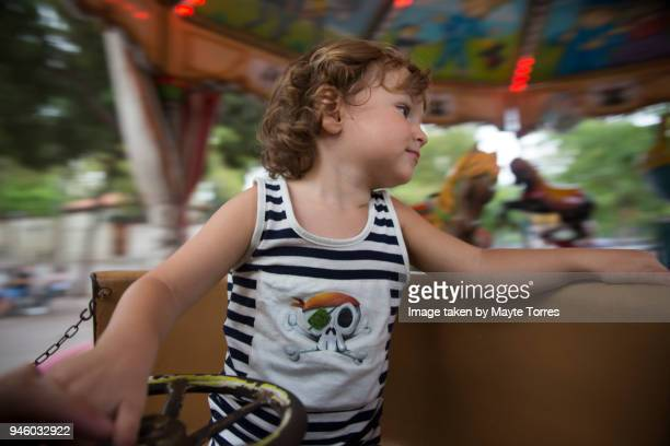Toddler going fast on the carrousel