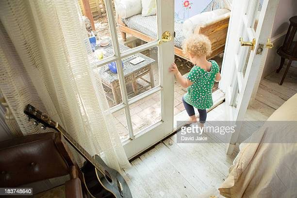 toddler going onto verandah - patio doors stock pictures, royalty-free photos & images
