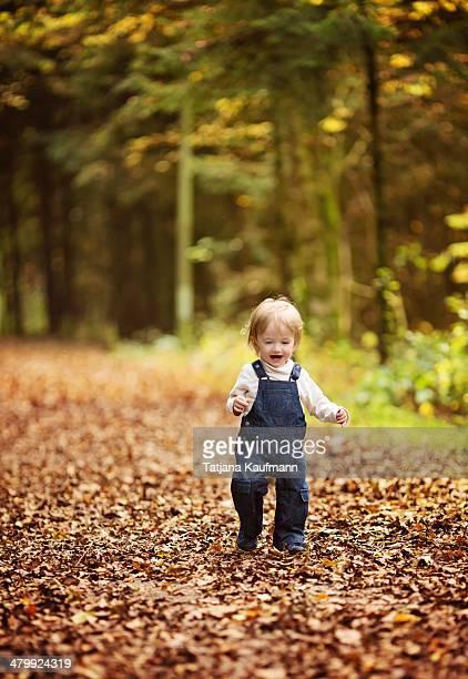 Toddler having Fun running around in the Woods