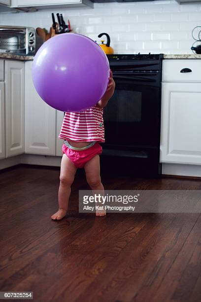 Toddler holding a big ball