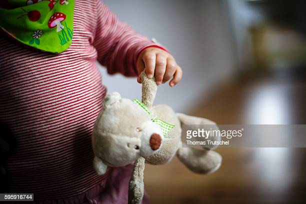 A toddler holds a stuffed animal in his hand on August 12 2016 in Berlin Germany