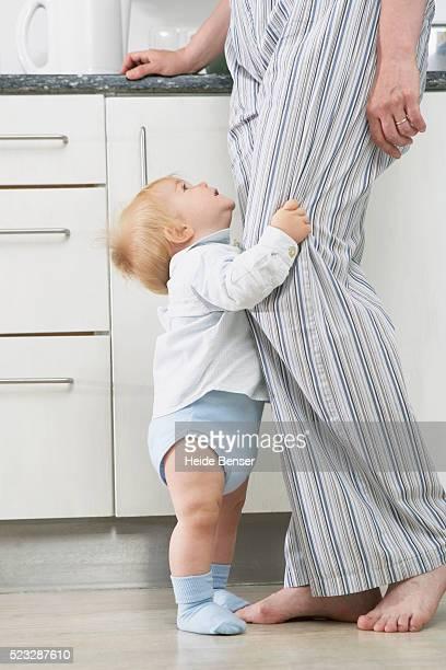 Toddler hugging man