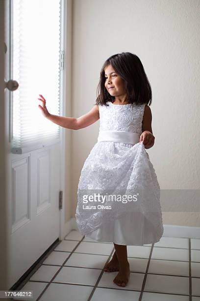 Toddler in a white dress