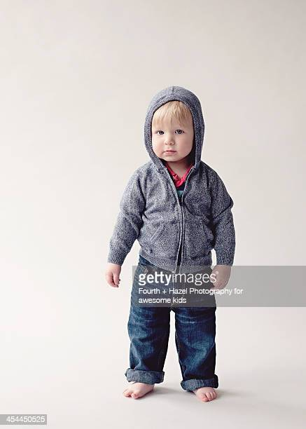 toddler in blue hoodie and jeans