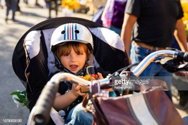 Toddler in Cargo Bike Eating Cherry Tomatoes