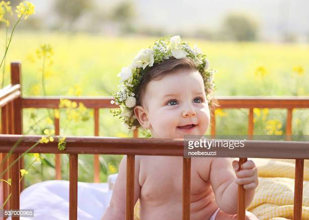 Toddler in crib outdoors