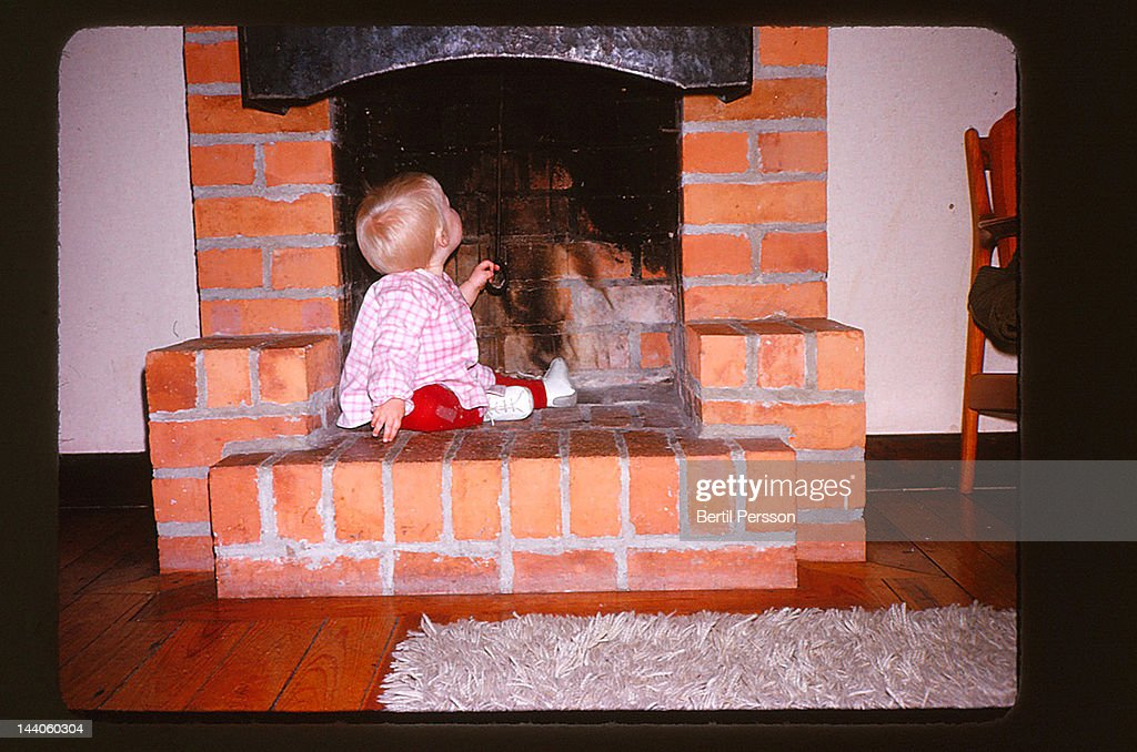 Toddler in fireplace : Stock Photo