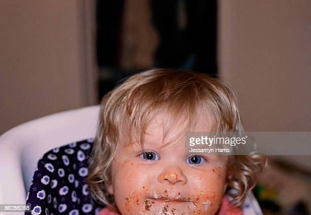 toddler in high chair with messy face - jessamyn harris stock pictures, royalty-free photos & images