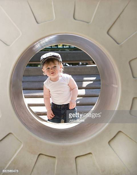 toddler in playground - peeping holes ストックフォトと画像