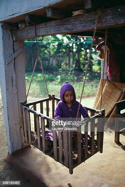 toddler in suspended cradle in nepalese village - terai stock pictures, royalty-free photos & images