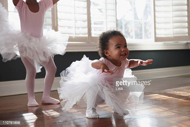 toddler in tutu, practicing dance moves - baby girls stock pictures, royalty-free photos & images