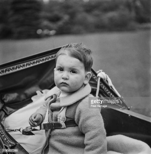A toddler is evacuated from London to Tunbridge Wells during World War II May 1941 A lanyard secures him to his pram
