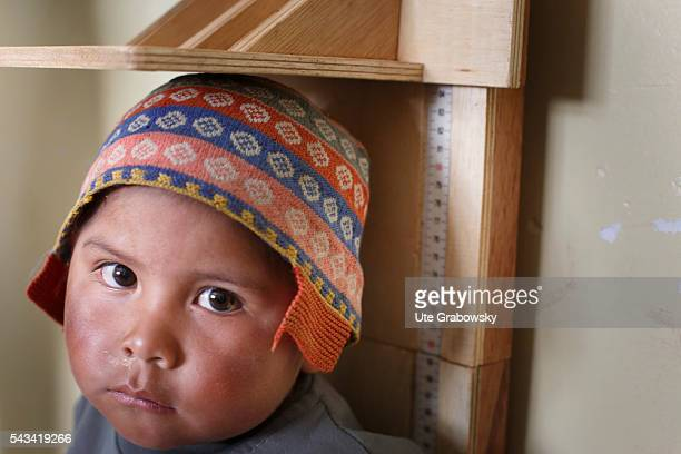 A toddler is measured at a health center in a small village in the Andes on April 23 2016 in Tawarchapi Bolivia