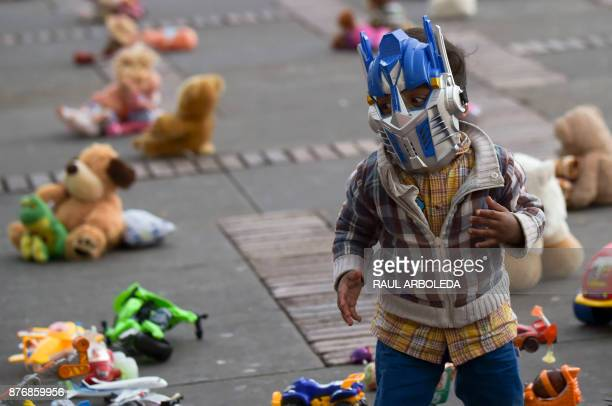 A toddler is pictured during an urban intervention at Bolivar square in Bogota to protest against child abuse and to raise awareness on children's...