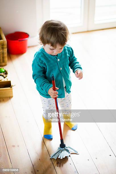 A toddler is playing with a mop on August 11 2016 in Berlin Germany