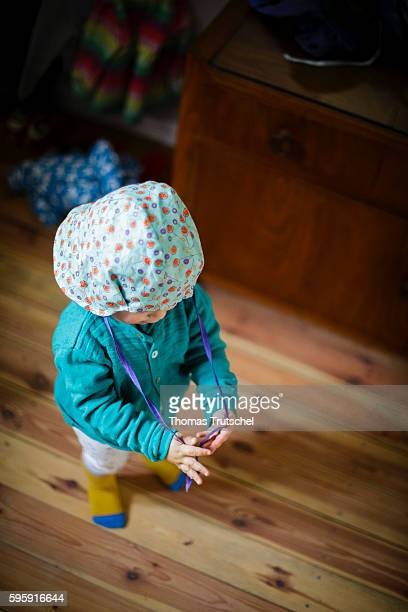 A toddler is putting on a hat on August 11 2016 in Berlin Germany