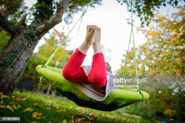 A toddler is rocking in a swing on October 17 2017 in Berlin Germany