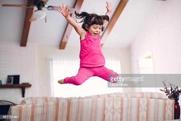 Toddler Jumps High Off The Sofa