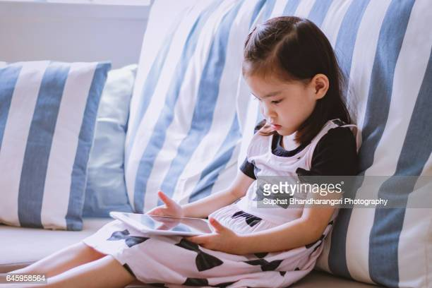 Toddler learning new things on a tablet