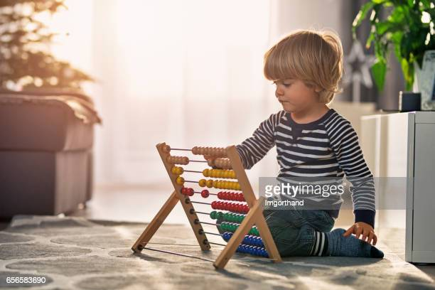 Toddler learning to count on abacus