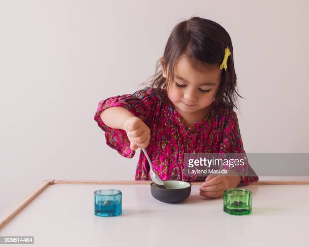 Toddler Learning To Sort With A Spoon