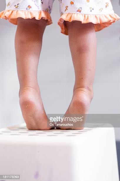 Toddler legs on tiptoe